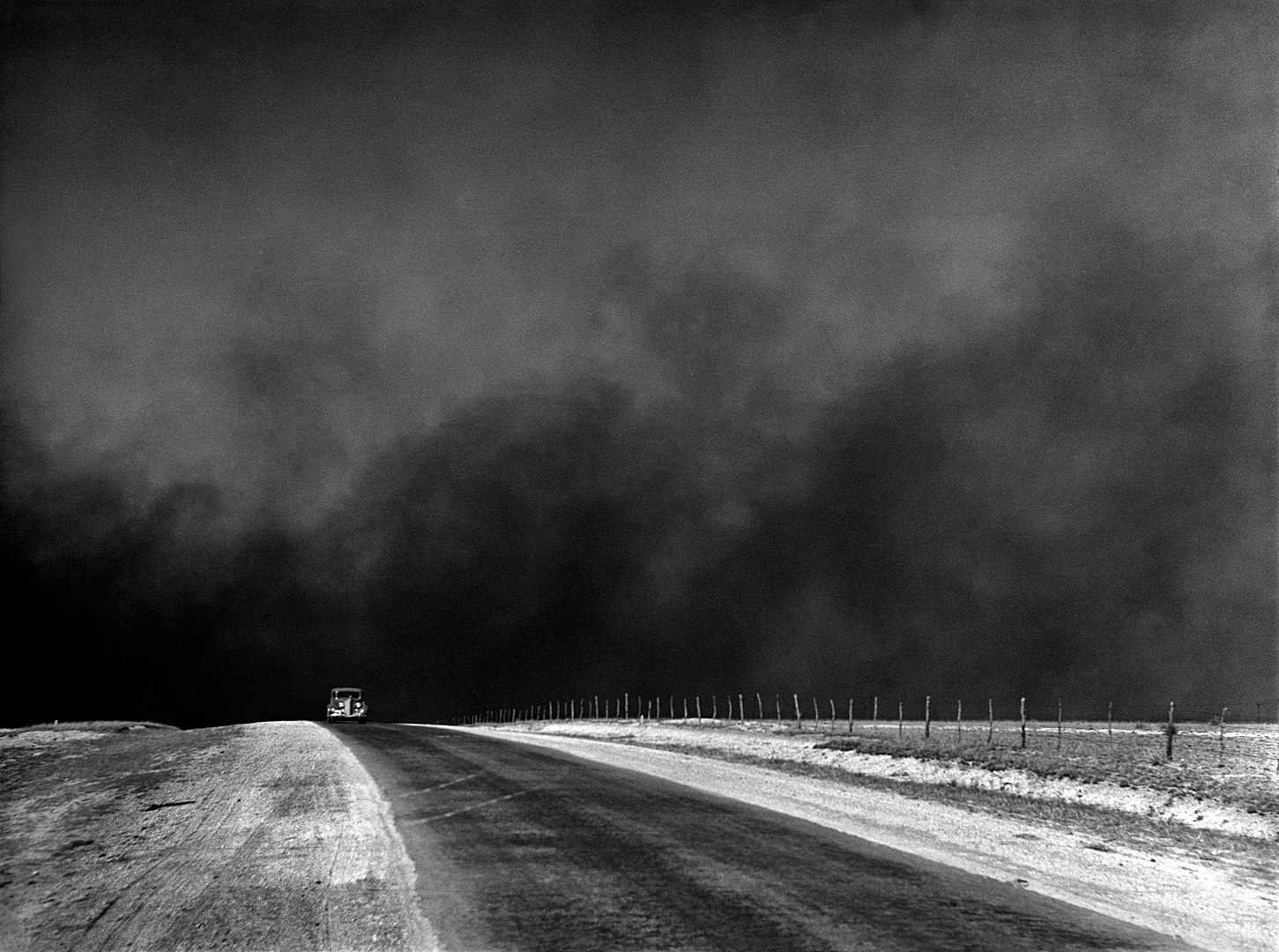 Heavy black clouds of dust rising over the Texas Panhandle, Texas, c. 1936