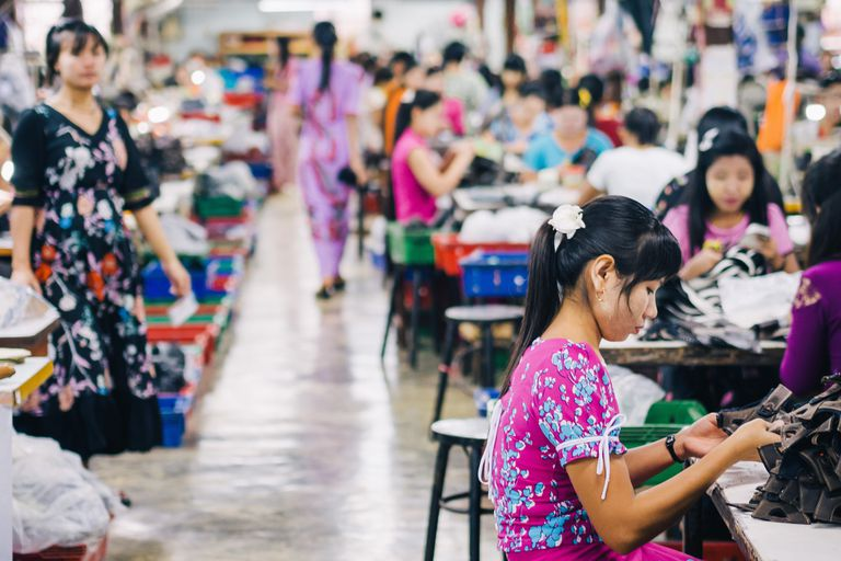 Fashion industry workers working in a factory
