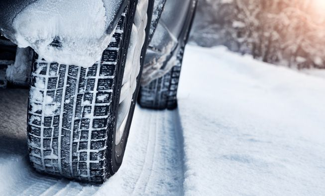 Tires with snow in the treads on a snowy day
