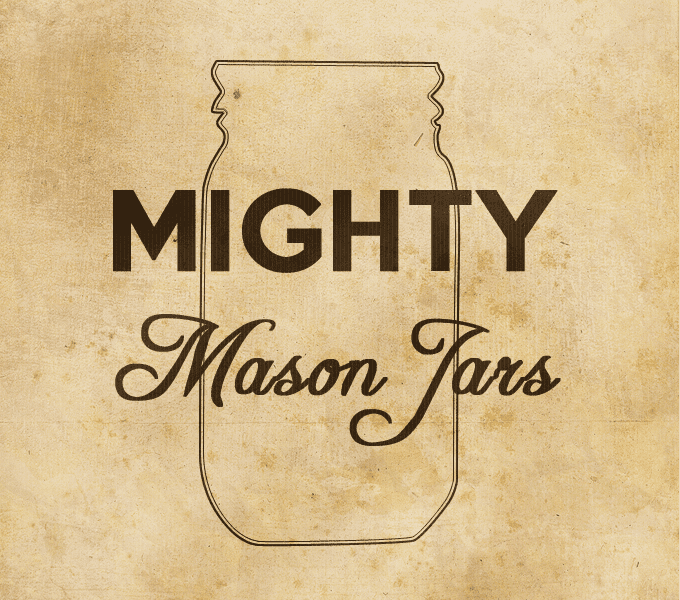 "Sign showing Mason jar outline with slogan reading ""Mighty Mason Jars"""