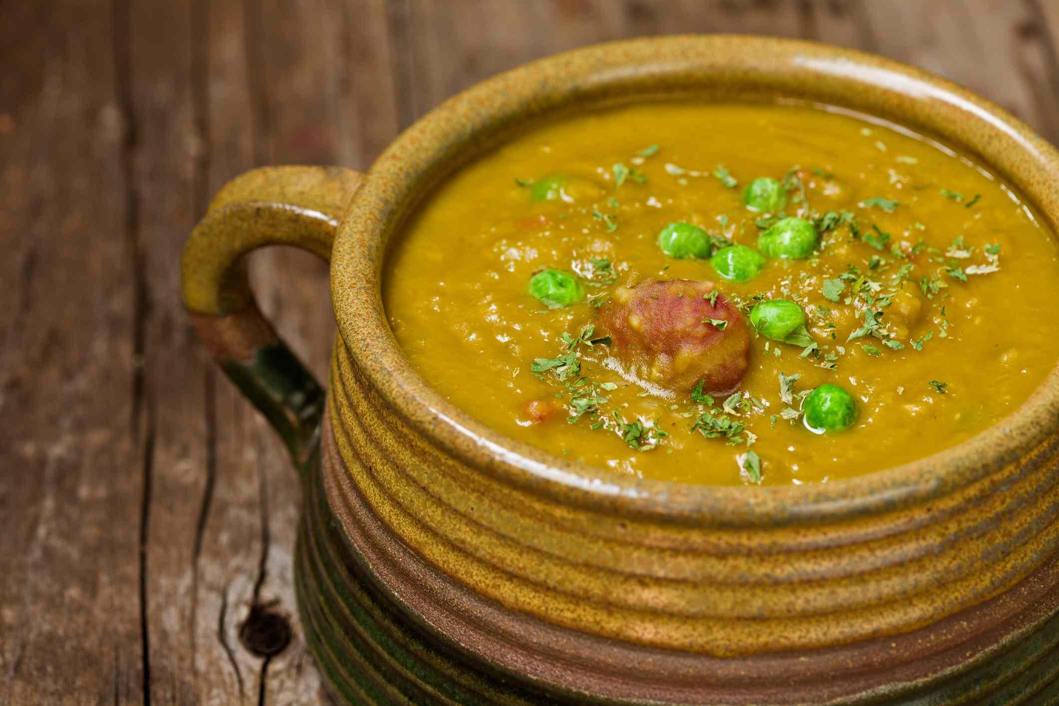 Split pea soup in an earthenware bowl