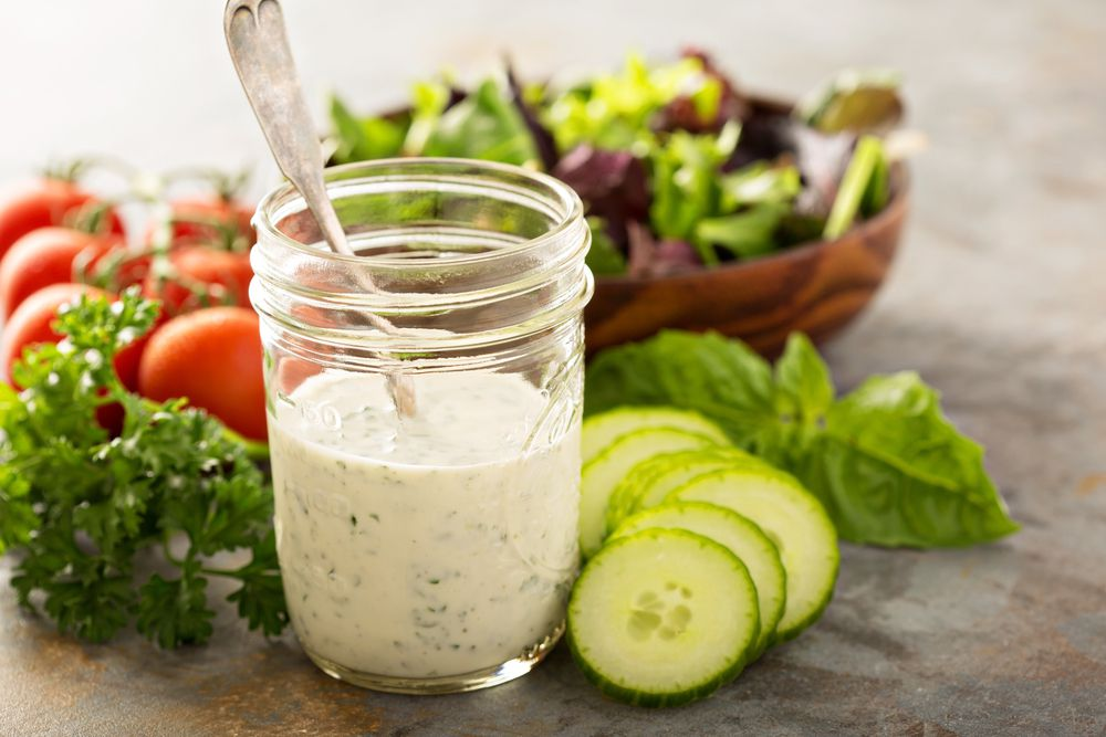 Homemade ranch dressing surrounded by vegetables
