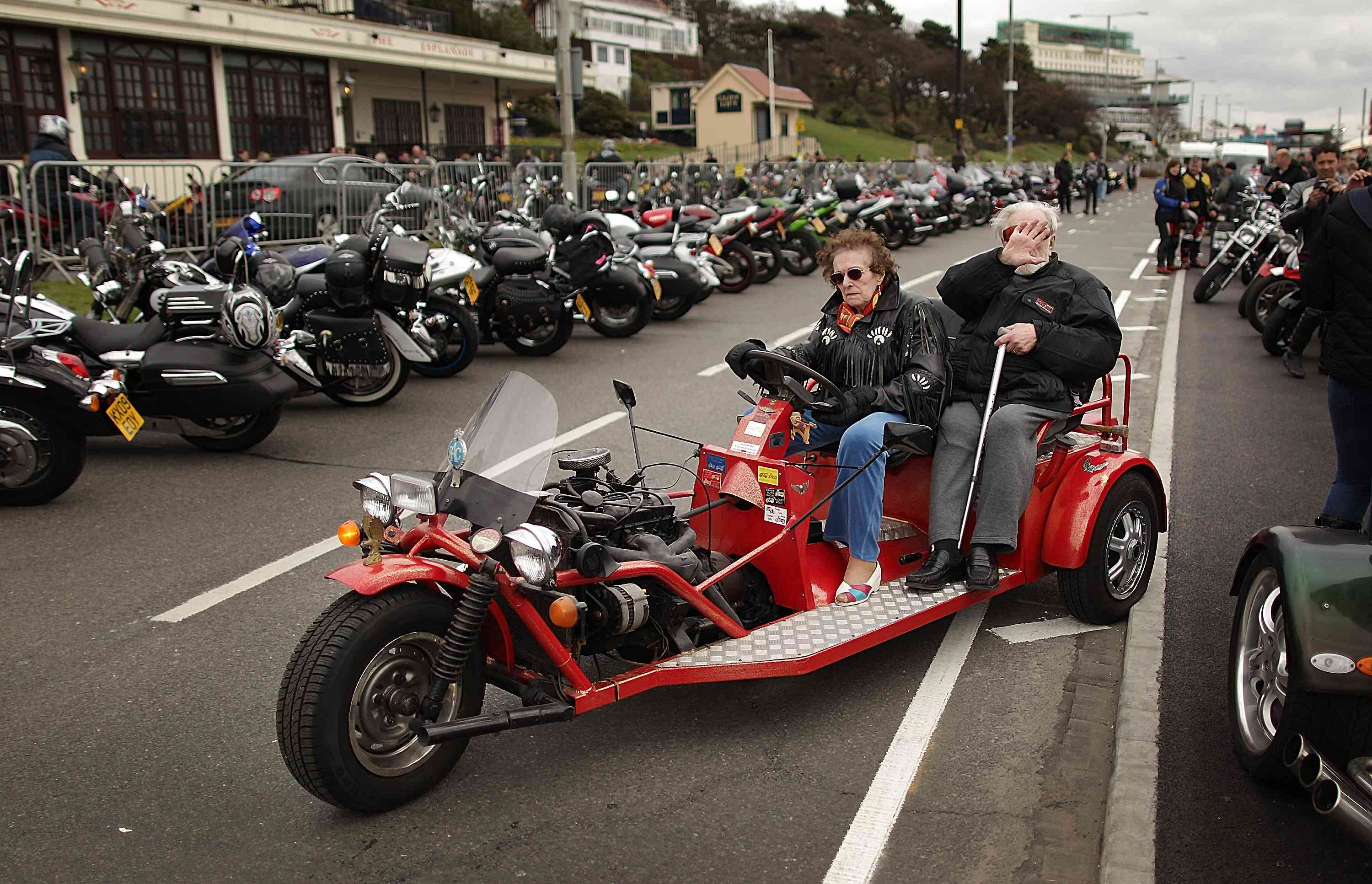 older couple on motorcycle with three wheels