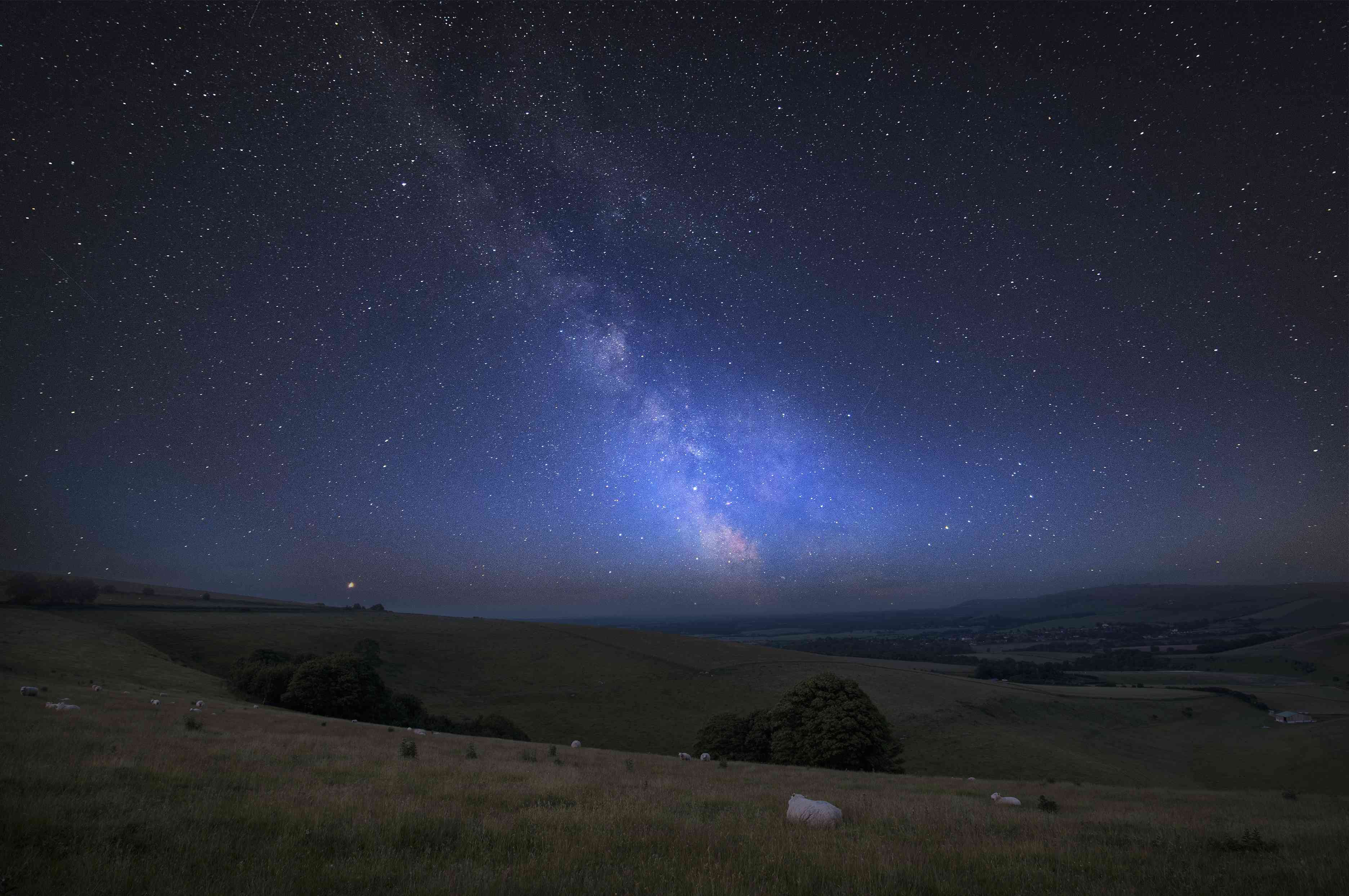 Vibrant Milky Way over grassy hillsides in South Downs