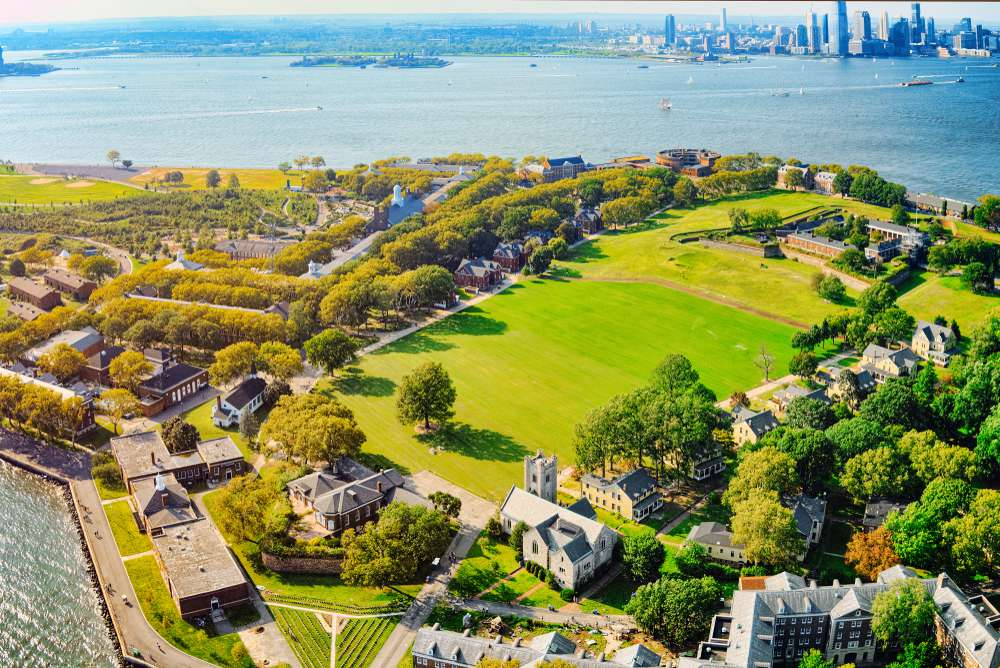 The grassy fields of Governors Island shine bright in the sun