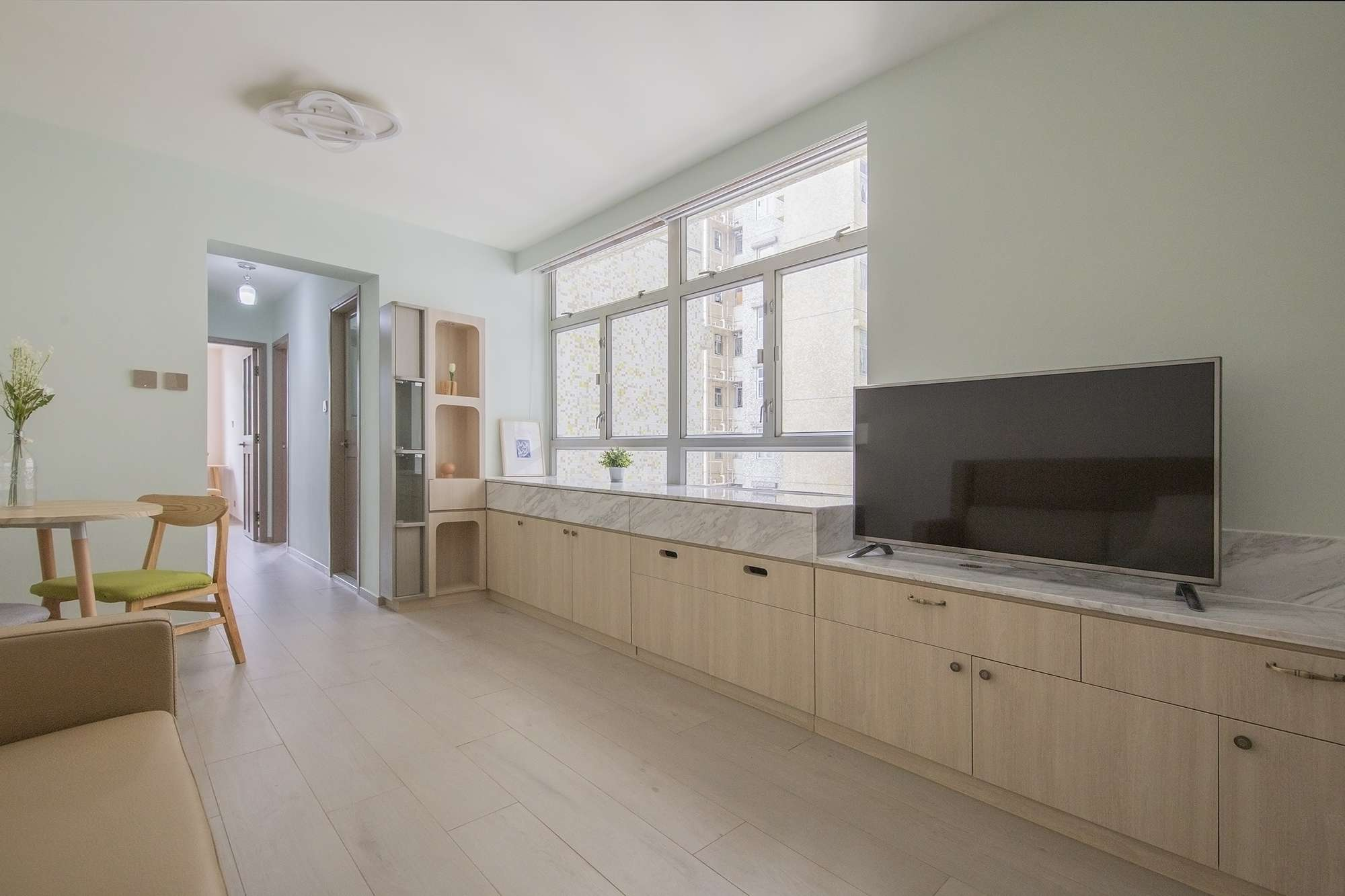Floral Aged House apartment renovation by Sim-Plex Design Studio living room