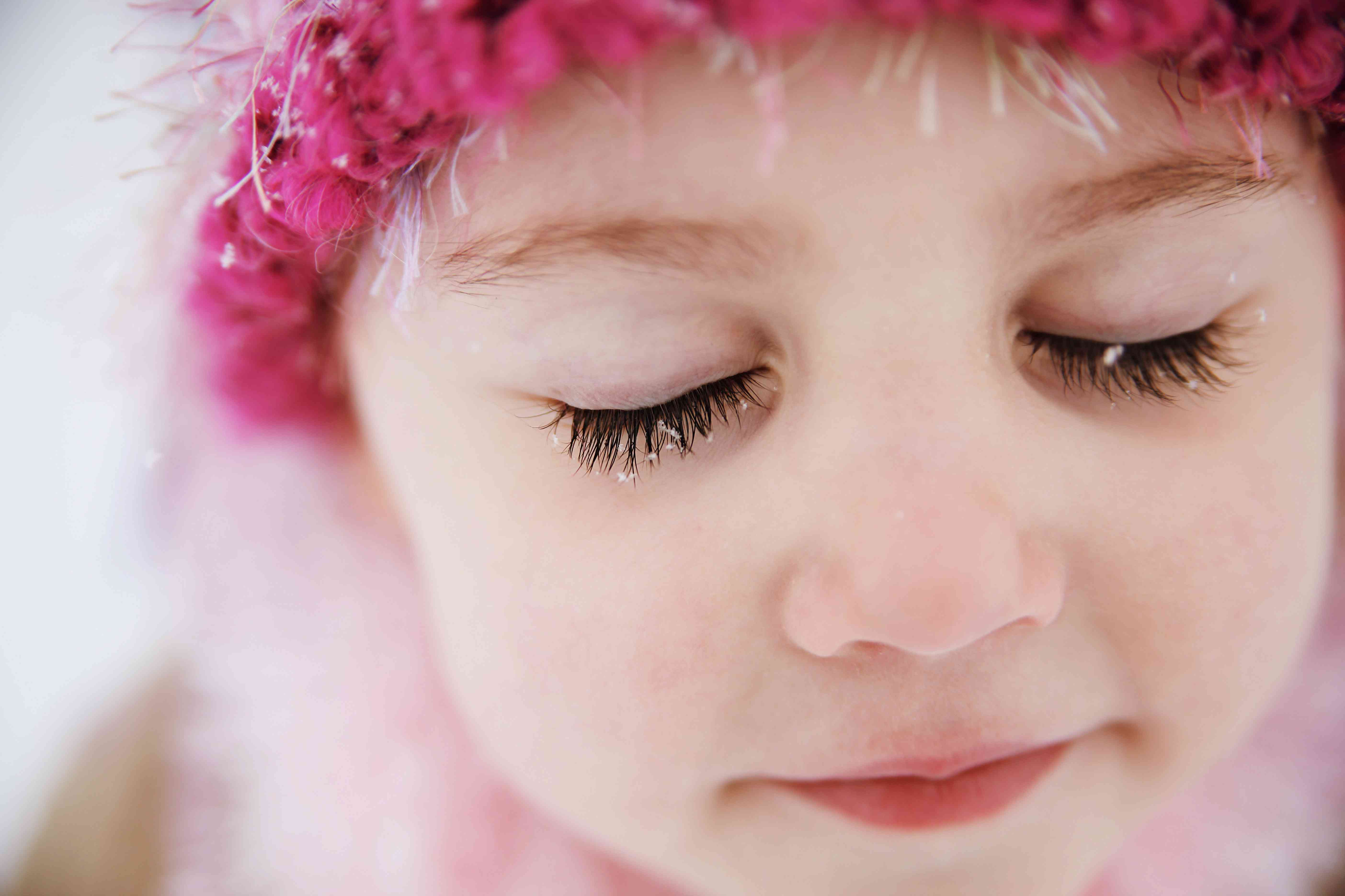 snowflakes in young girl's eyelashes