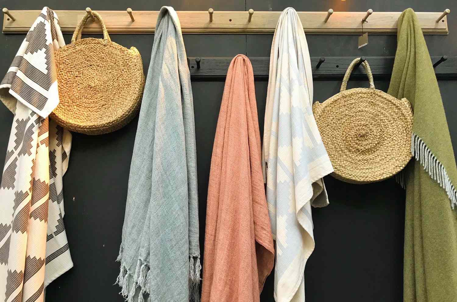 baskets and blankets on hooks