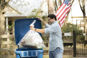man puts out recycling