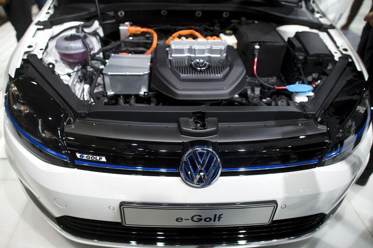 An open hood reveals the motor of a Volkswagen e-Golf electric car.