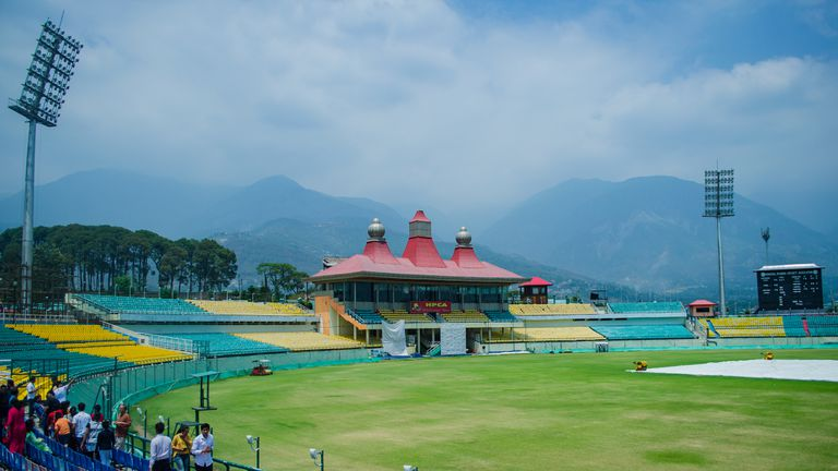 A small crowd at a cricket field in Dharamsala