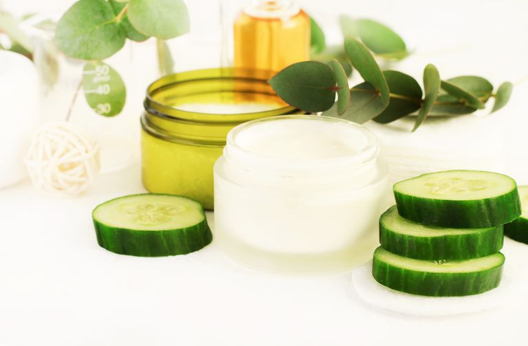 Natural cosmetic products, eye cream in jar, essential oil