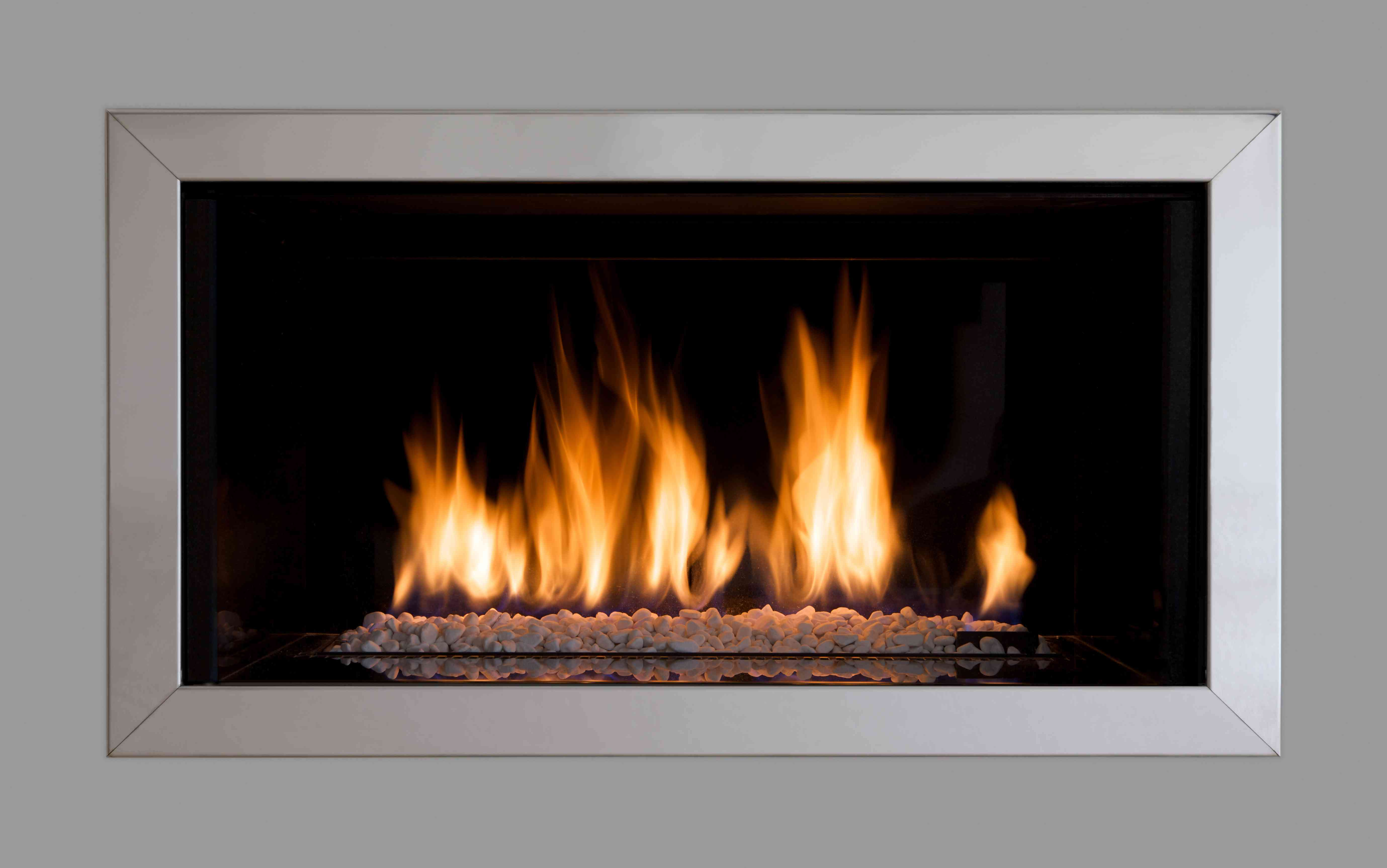 Rectangular gas fireplace with a gray steel border