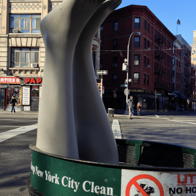 Mannequin legs poking out of NYC trash can