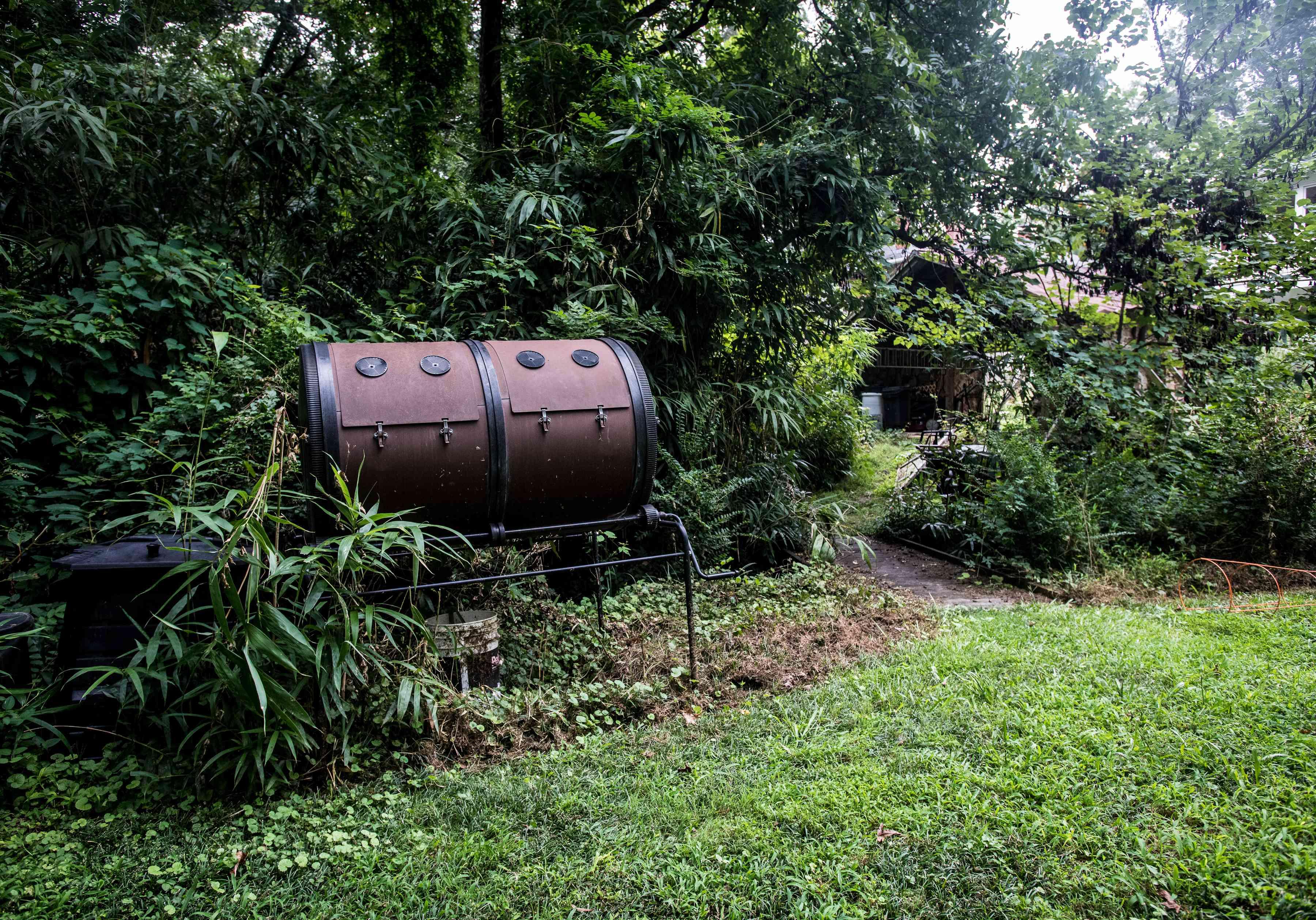 brown double barrel compost bin outside in greenery