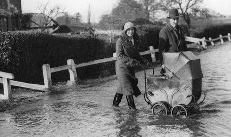 A family walking in flood waters
