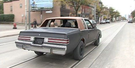 pedal powered buick driving down the road