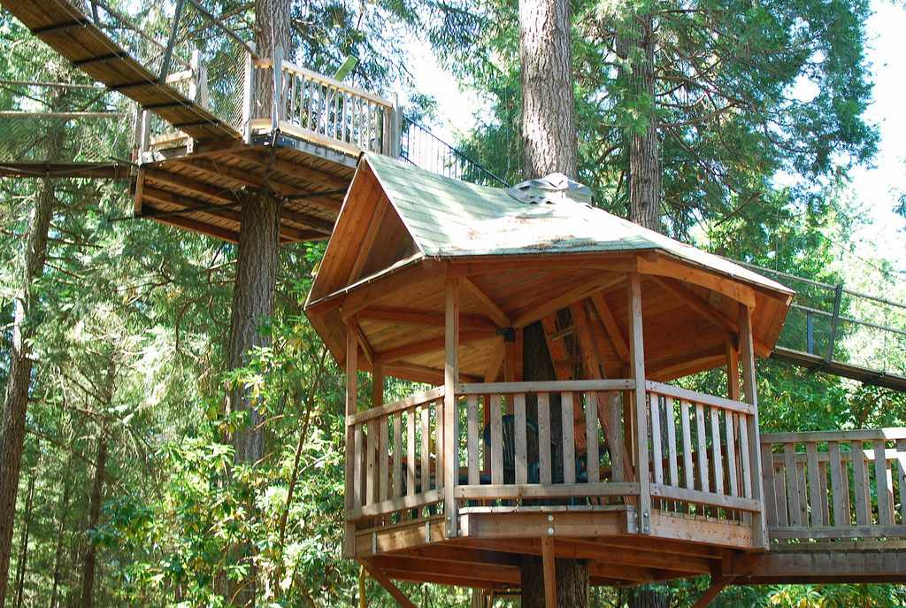 Suspended decks wrapped around trees and connected with bridges at Out 'n' About Treehouse Treesort in Takilma, Oregon