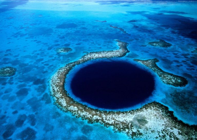 An aerial view of the Great Blue Hole in Belize