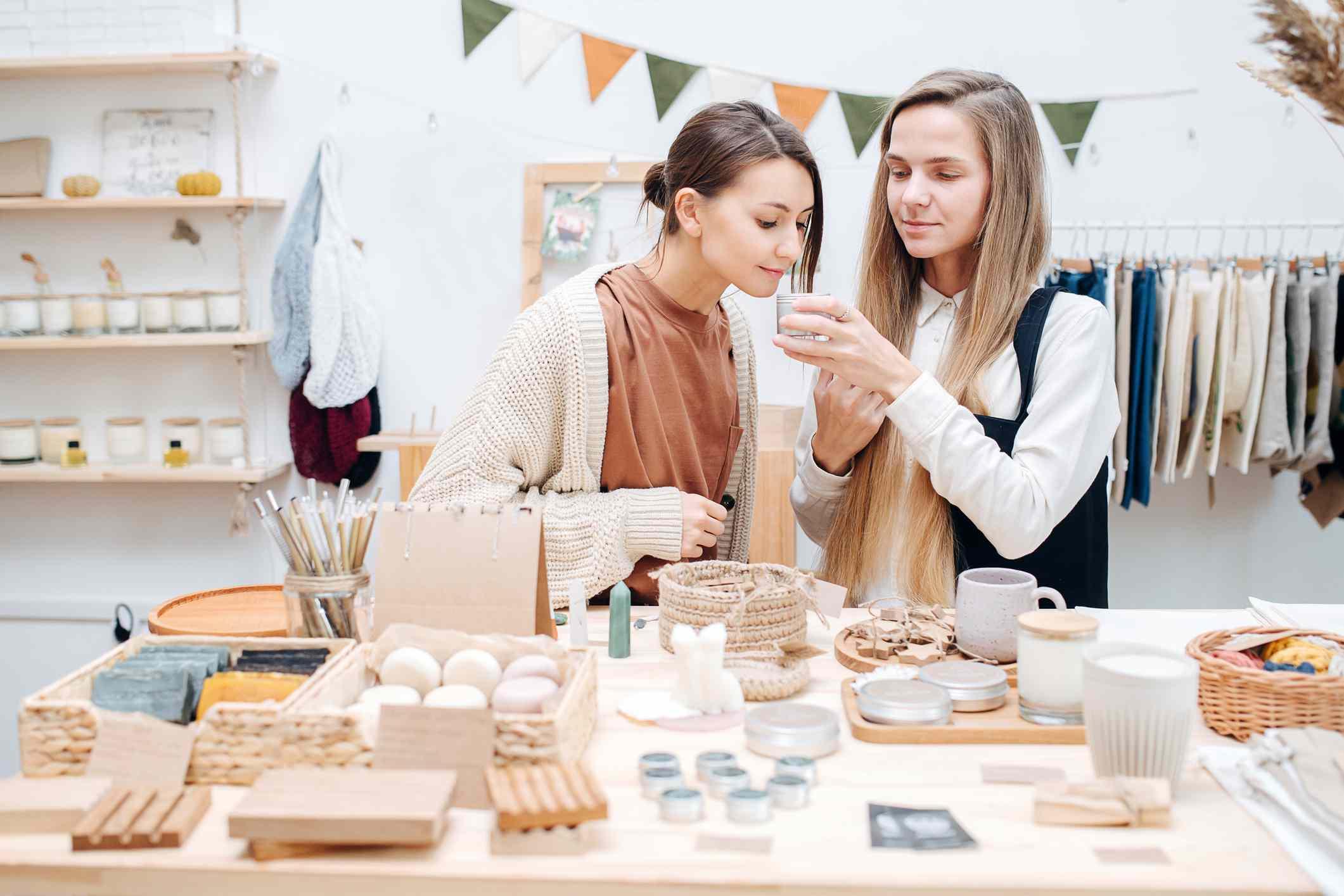 Two white women shopping for vegan cosmetics at a zero waste store.