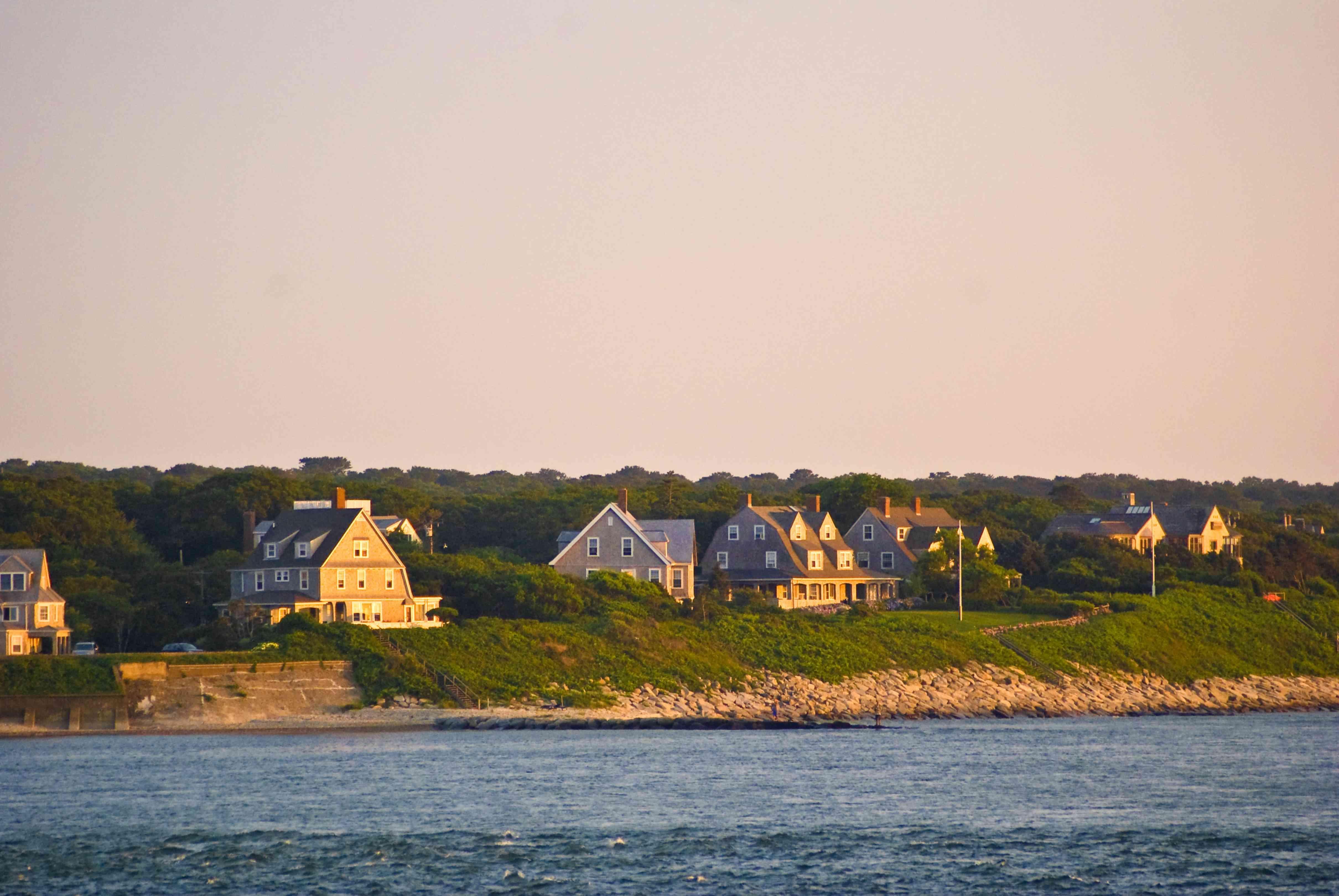Houses along Cape Cod coast at sunset