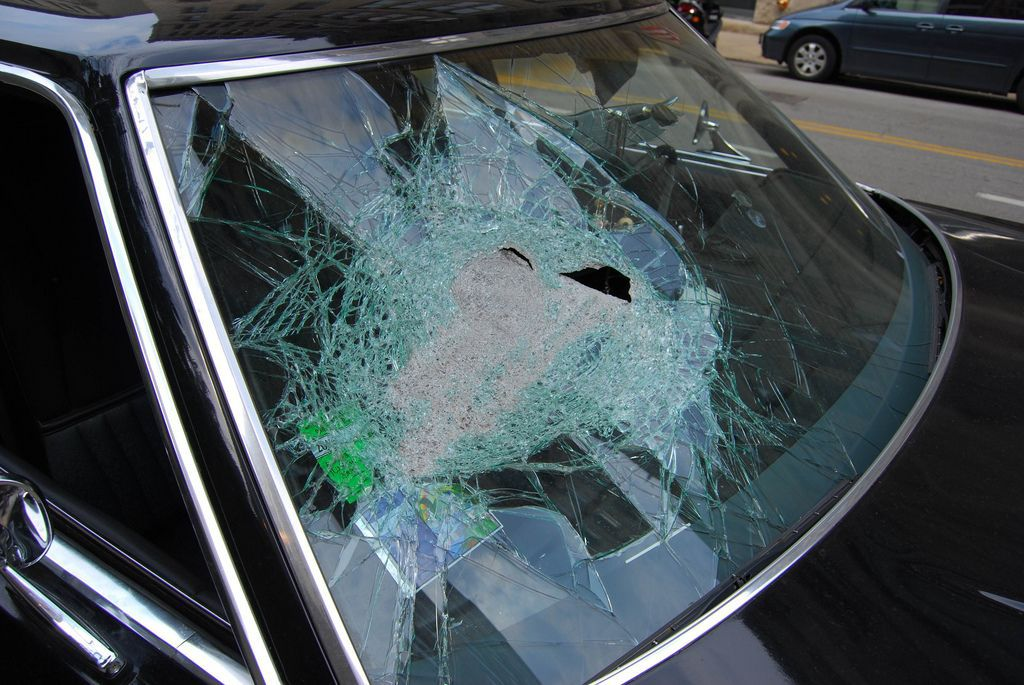 smashed windshield fixed with duct tape