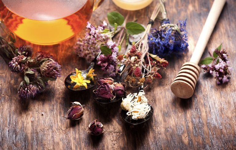 Herbs and honey on a wooden table