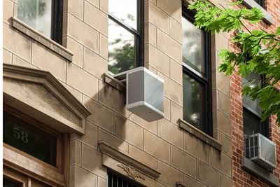 Gradient heat pump on outside of building