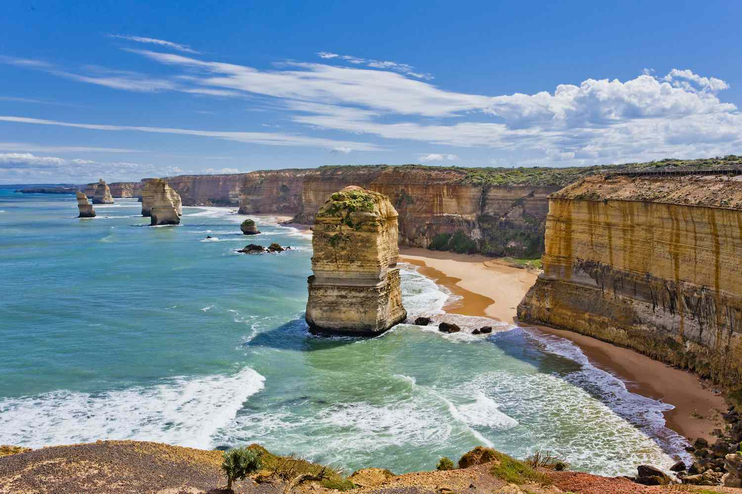 The stacks known as the 12 Apostles jut out of the ocean on the Australian coast