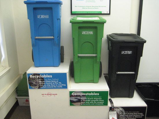 Different waste bins on display in a room.