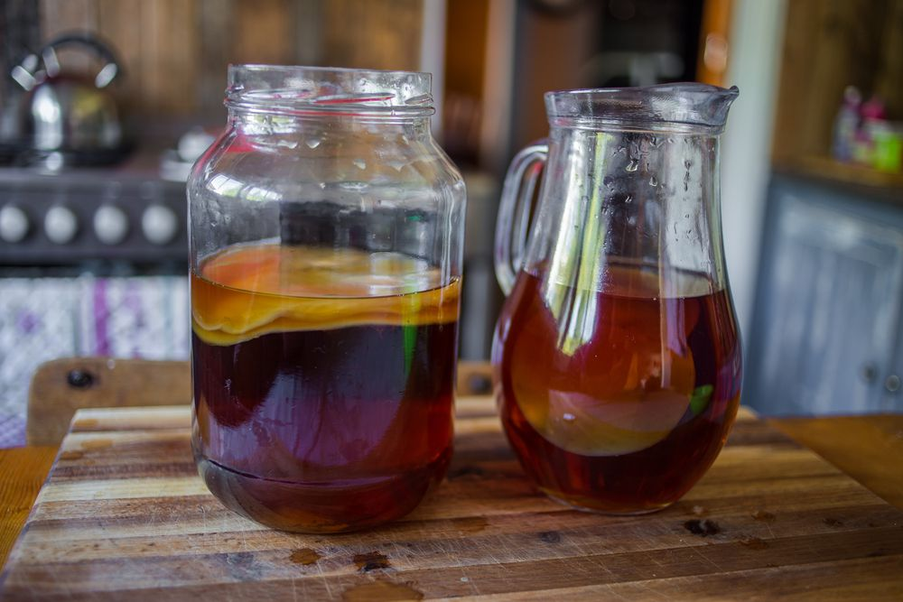 jar and pitcher of kombucha tea