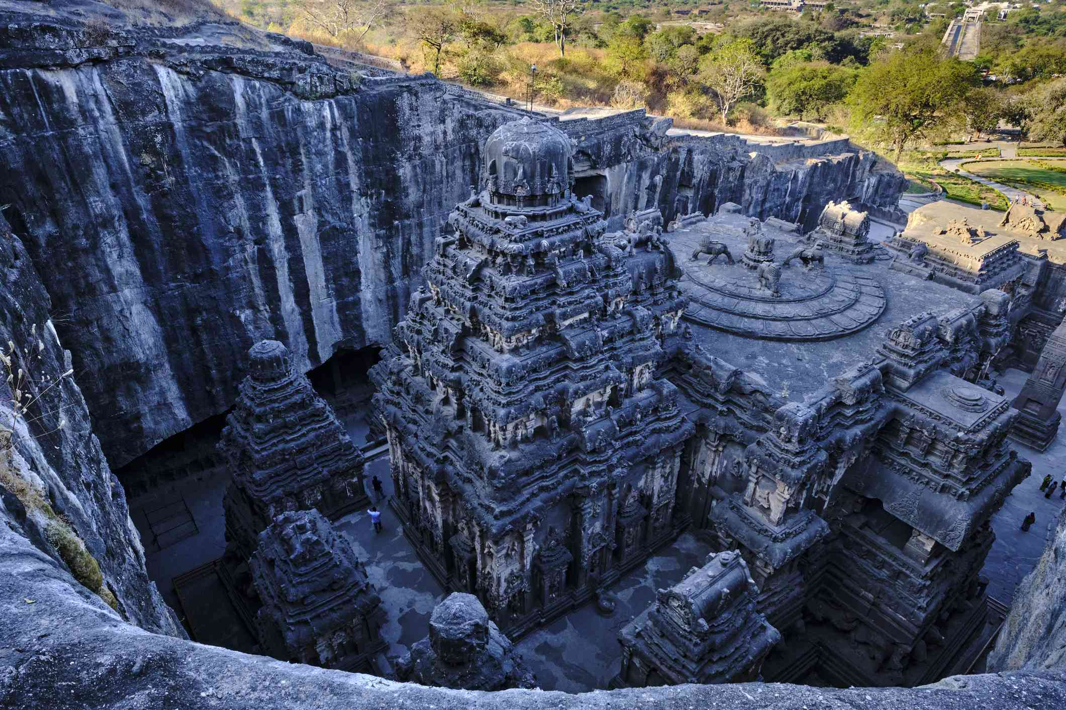 Aerial view of the Ellora cave temple surrounded by green foliage