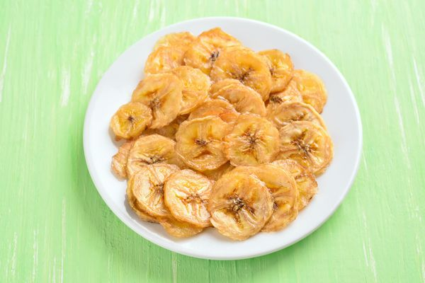 plate of dehydrated banana chips on a table