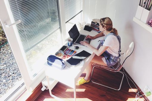 woman working from home near window