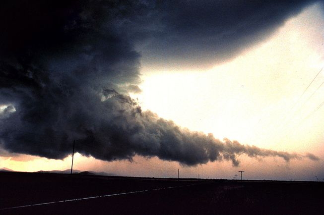 A wall cloud with a tail extending from the base