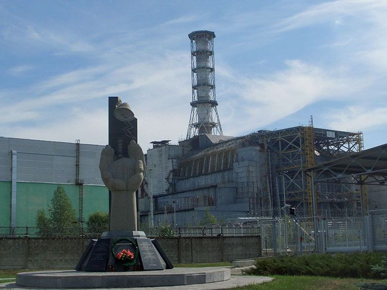 View of Chernobyl monument and sarcophagus around the reactor number 4, site of the worst nuclear accident yet