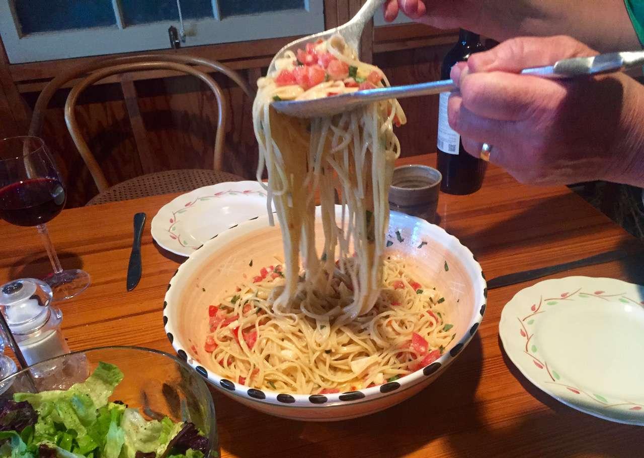 mixing pasta