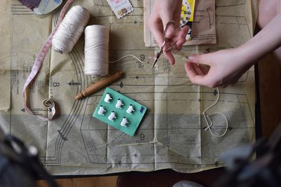 Hands sewing with pattern and threads