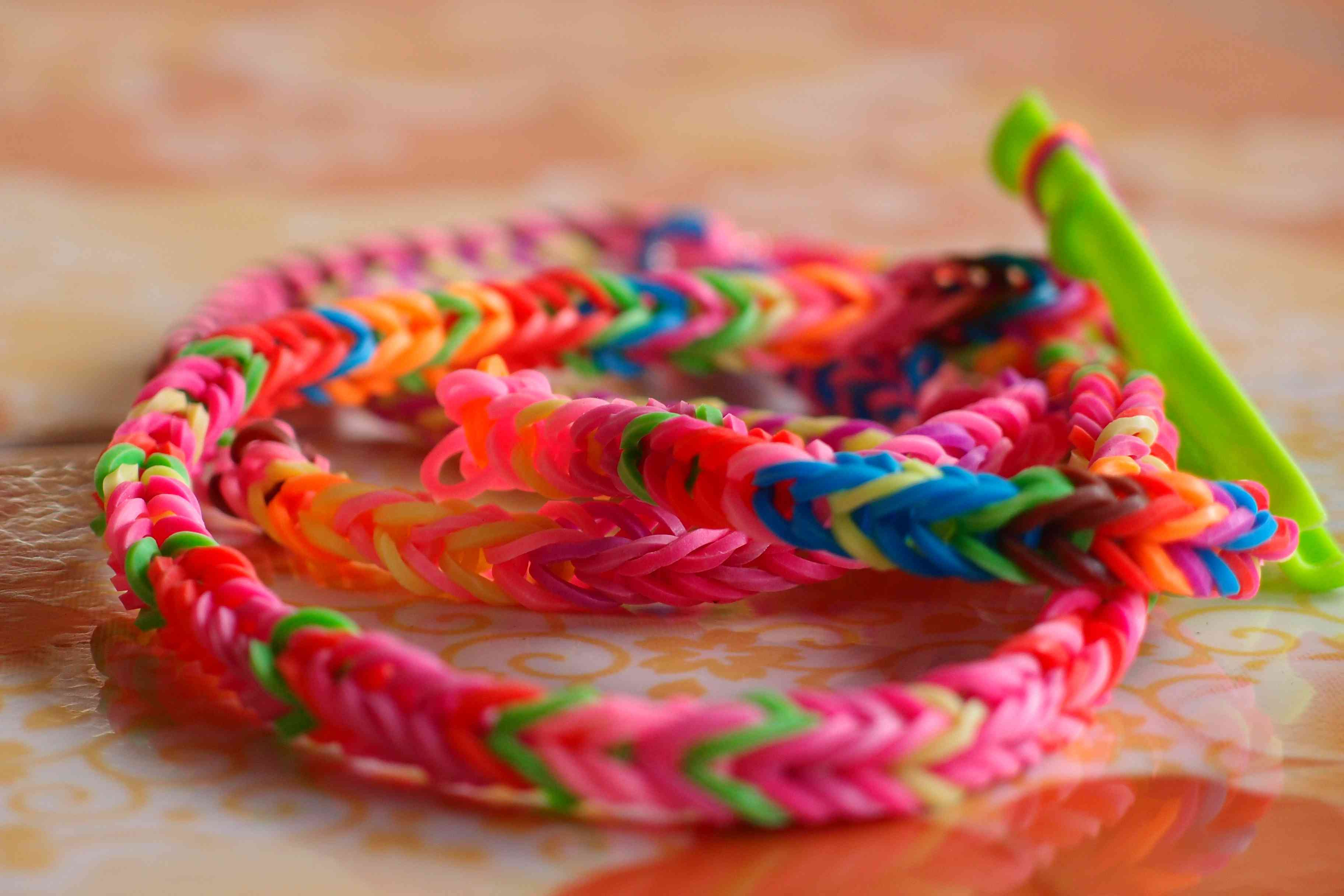 brightly colored rubber band jewelry