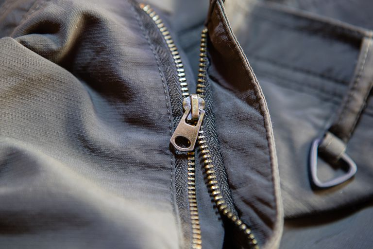 Zipper on a pair of pants split from the bottom