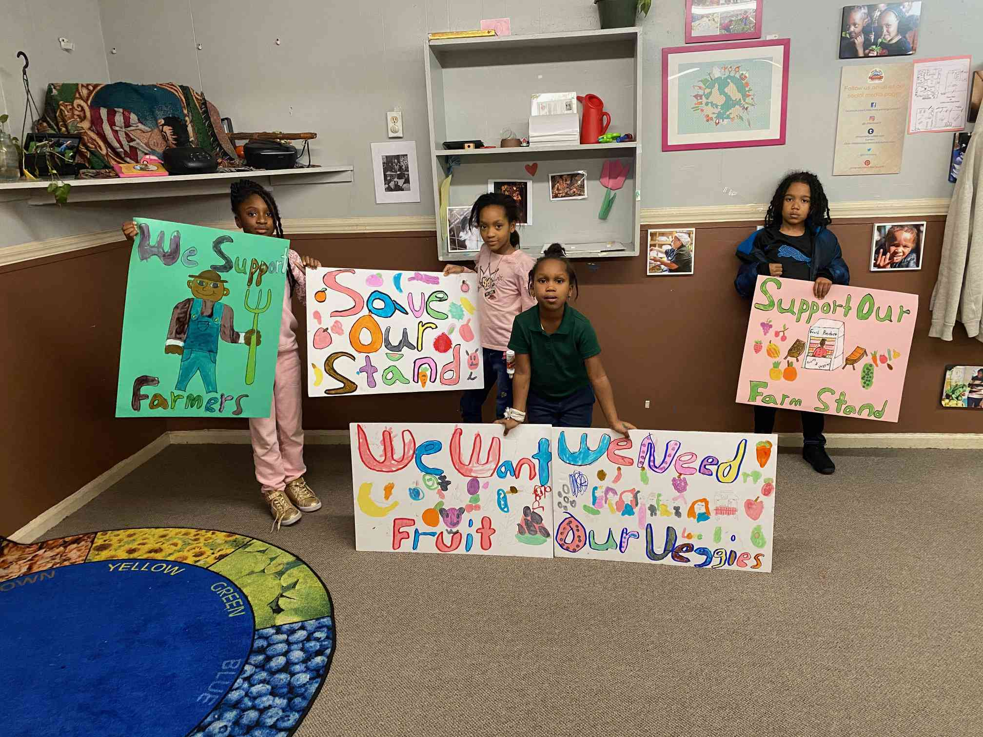 students with signs for farm stand
