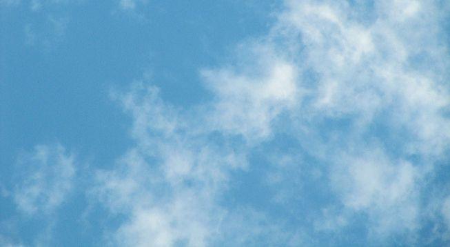Cumulus fractus clouds against a blue sky.