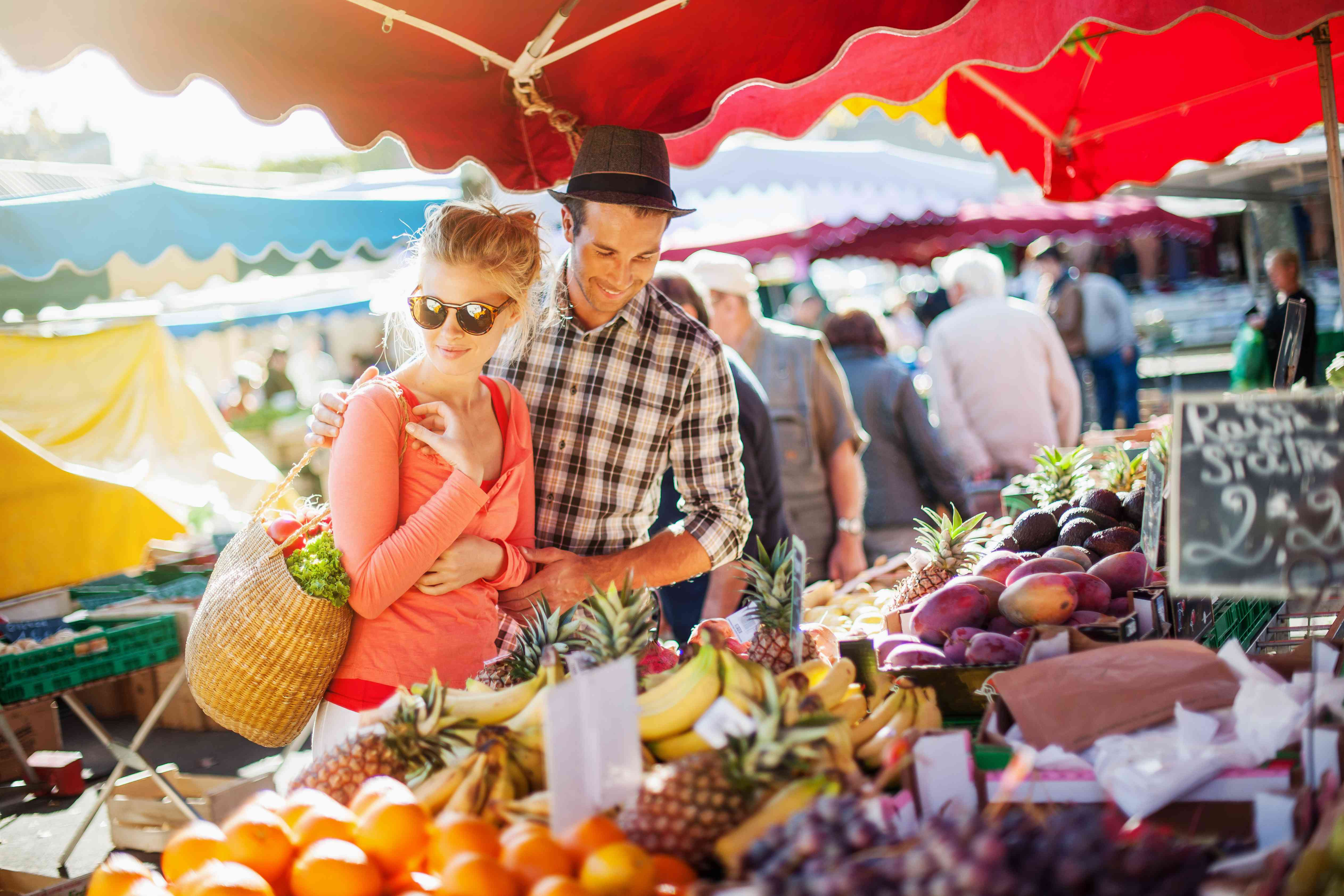 A couple shops at a farmers market