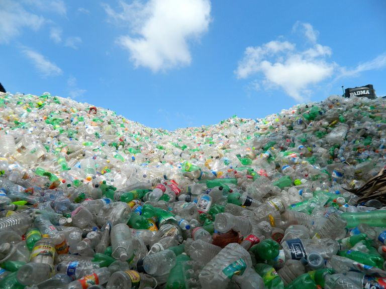 Heap of plastic bottles against sky