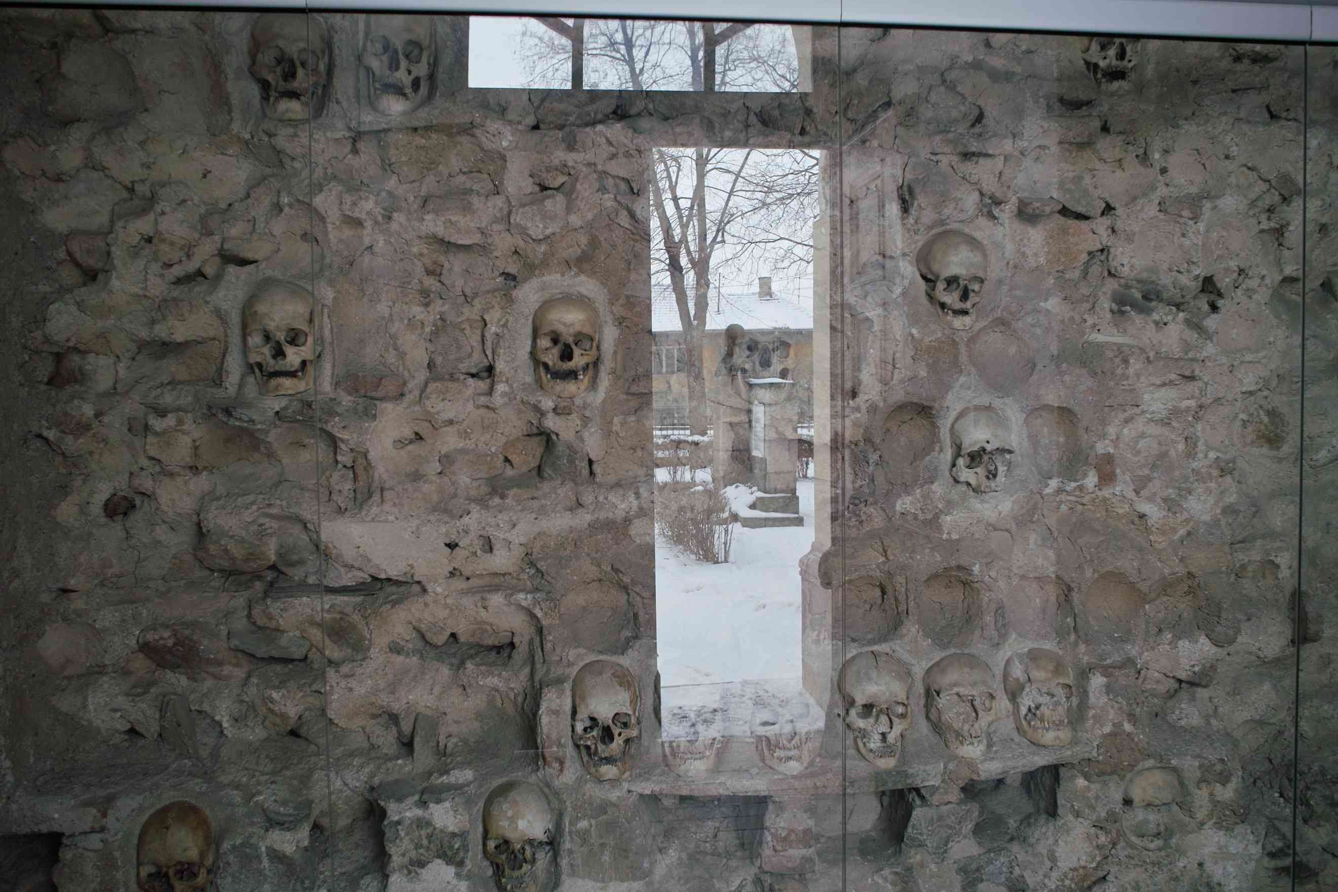 Skulls embedded within the wall of Skull Tower in Nis, Siberia