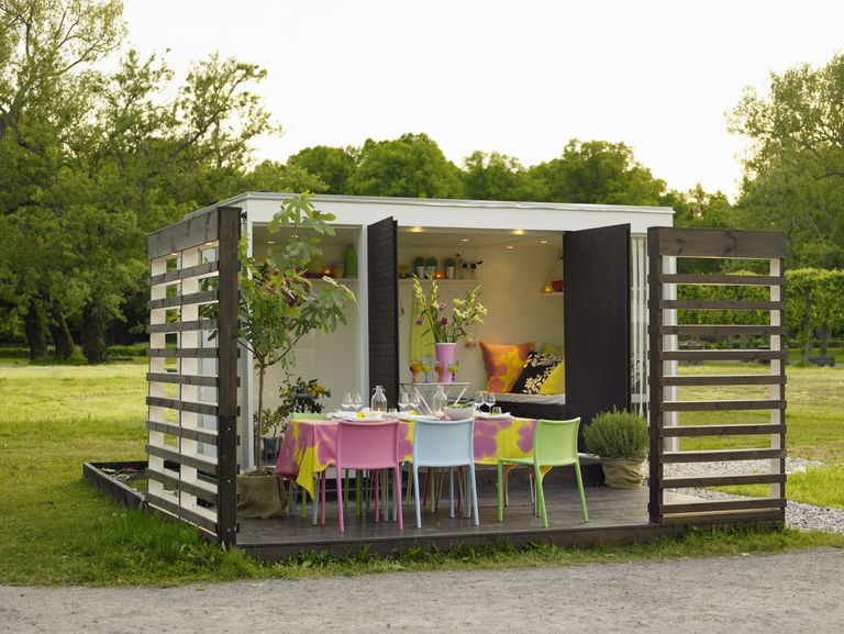 A modern shed set up for a dinner party.
