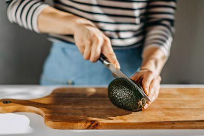 Woman cutting avocado