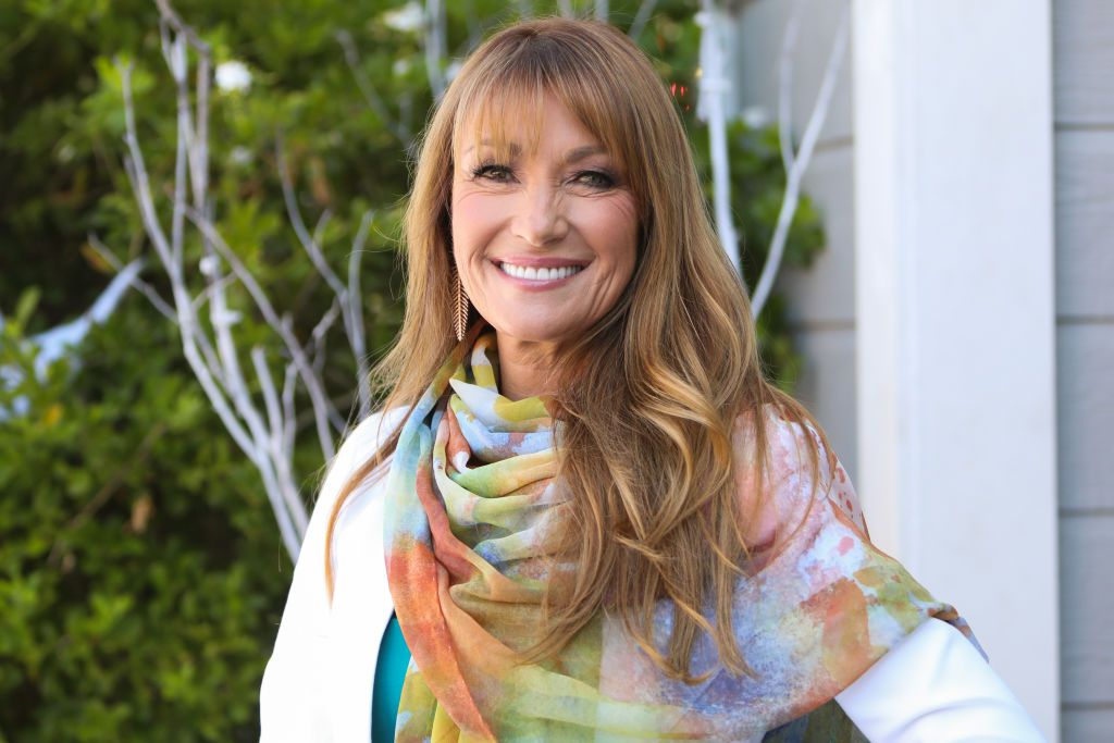 Actress Jane Seymour wearing a colourful scarf outside.