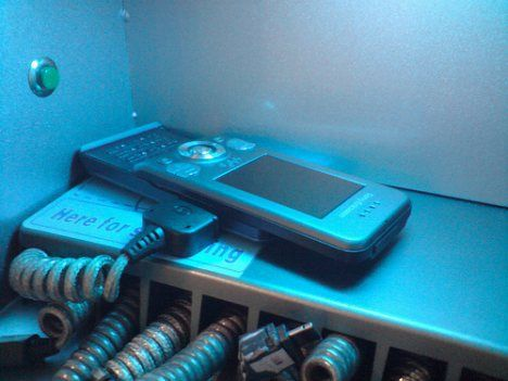outdated cell phone charging station with large wires and plugs