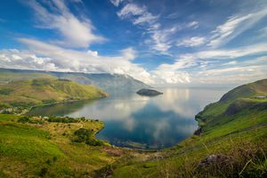 An aerial view of Lake Toba in Indonesia with lush green vegetation around it.